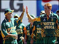 South Africa captain Shaun Pollock celebrates with Herschelle Gibbs