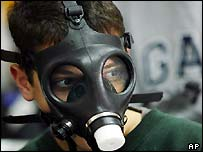 An Israeli schoolboy wearing his gas mask participates in a drill in a Jerusalem school