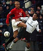 Manchester United defender Wes Brown and Bolton player Youri Djorkaeff