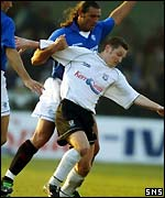Lorenzo Amoruso tussles with Ayr striker James Grady