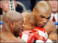 Mike Tyson throws a powerful right hand at Clifford Ettienne.