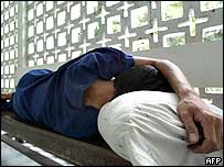 A Thai drug addict sleeps while attending a drug detoxification program at Thanyarak hospital in Bangkok
