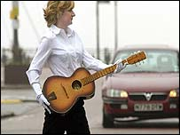 Sandra Quayle with Harrison's guitar