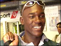 Collins Obuya smiles at the airport on his way to South Africa