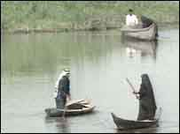 Marsh Arabs in their customary high-prowed canoes