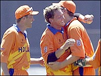 Holland's Henk Mol is congratulated by team-mates after taking the wicket of Waqar Younis