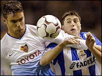 Alexandre Quennoz of Basle (left) and Deportivo la Coruna striker Diego Tristan