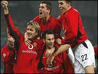 Ryan Giggs is mobbed by team-mates after scoring his second goal against Juventus