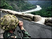 Pakistani soldier looks at Indian positions on front line