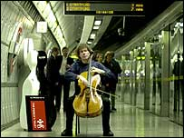 Cellist Julian Lloyd Weber busking on a Tube platform