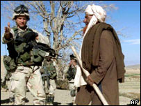A US troop and an Afghan villager