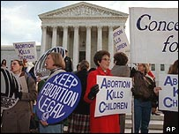 Pro-choice and anti-abortion protesters mingle outside the Supreme Court