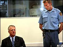 Vojislav Seselj seated in court