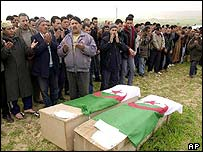 People mourn massacre victims, February 2003