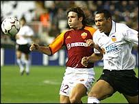 Vincent Candela (left) battles with Valencia's John Carew