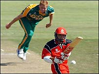 South Africa's Shaun Pollock (left) bowls to Canada's Ishwar Maraj