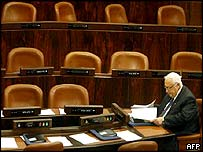 Ariel Sharon prepares papers in an empty Knesset