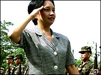 Gloria Arroyo salutes her troops