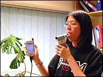 Woman using the e-San asthma monitoring devices