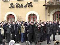 Employees see off the funeral cortege