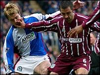 Blackburn's Garry Flitcroft challenges Kevin Horlock