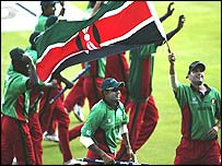 Ravindu Shah (with stump) and Hitesh Modi (with flag) lead the lap of honour celebrations after Kenyas victory over Bangladesh