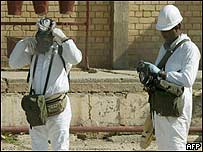 UN inspectors in chemical protection suits