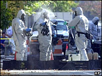 Officers in chemical suits