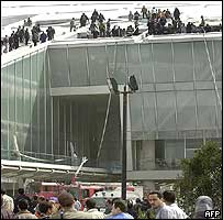 People climb onto the roof of the Bibliotheca Alexandrina