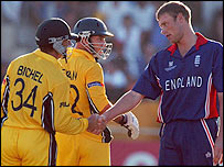 England's Andrew Flintoff shakes hands with Andy Bichel