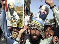 Anti-war protesters in Pakistan chant as they hold pictures of Osama Bin Laden