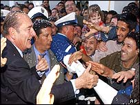 Chirac (l) greets the crowd in Algeria