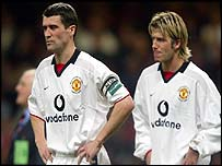 Roy Keane and David Beckham look dejected after the Worthington Cup final