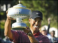 Tiger Woods shows off his trophy