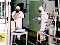 Workers check for radiation inside the Tokaimura plant