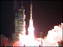 A Long March launches a Shenzhou capsule into orbit