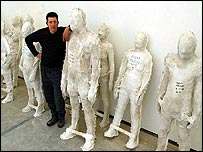 Antony Gormley with moulds taken from some of the volunteers' bodies