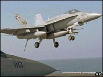 A US F-18 Hornet jet returning from a routine patrol
