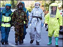 Emergency crews in chemical protection suits