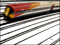 A train runs through icy conditions