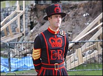 Beefeater patrols collapsed moat wall at the Tower of London