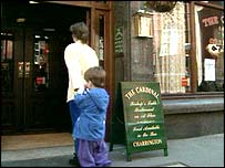 A mother takes her child into a pub