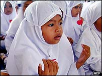 Acehnese children pray together at Baiturrahman mosque in Banda Aceh