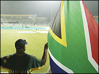 A fan waves the South African flag after the game with Sri Lanka