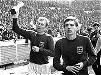 Martin Peters (right) celebrates winning the World Cup in 1966 with captain Bobby Moore