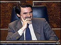Spanish Prime Minister Jose Maria Aznar smiles as his party defeats an opposition motion on Iraq