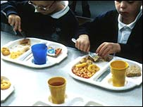 Pupils eating chips and beans