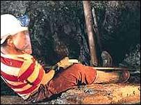 Gold miner working below ground