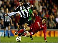 Middlesbrough's Juninho tackles Newcastle's Jermaine Jenas