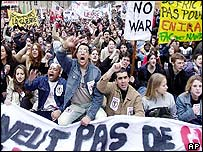 Students march with banners in Paris
